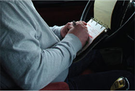Image of a man taking notes